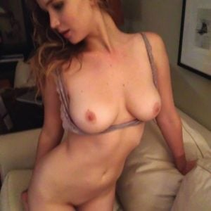 celeb hacked pic of Jennifer Lawrence with her tits out and pussy exposed on couch