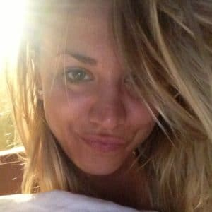 up close pic of actress kaley cuoco making a duck face