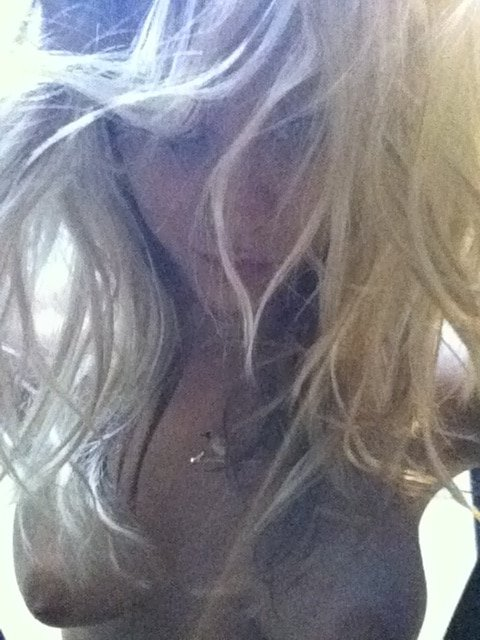 sexy leaked pic of kaley cuoco showing off her tan nipples in selfie with hair in her face