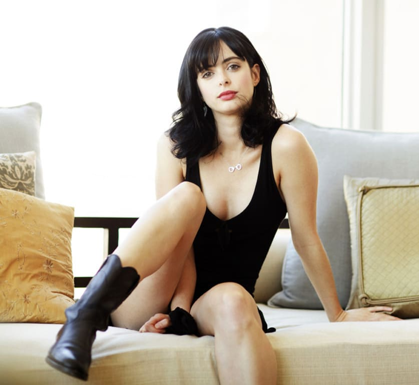 the celebrity Krysten Ritter wearing combat boots and black top