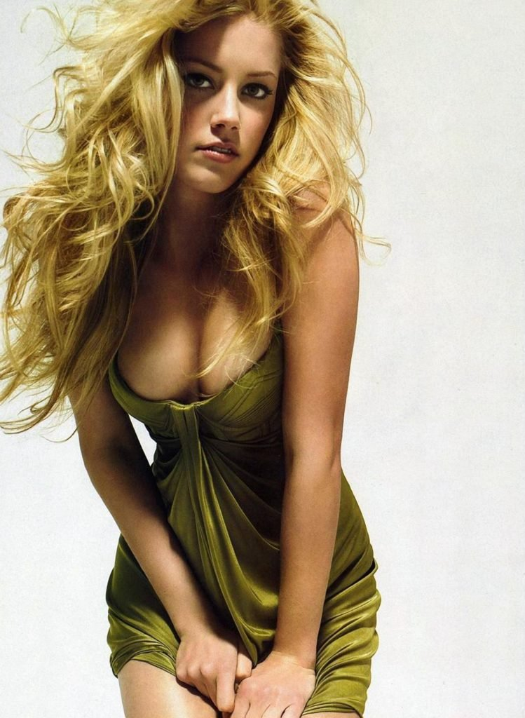Amber Heard showing cleavage in green dress