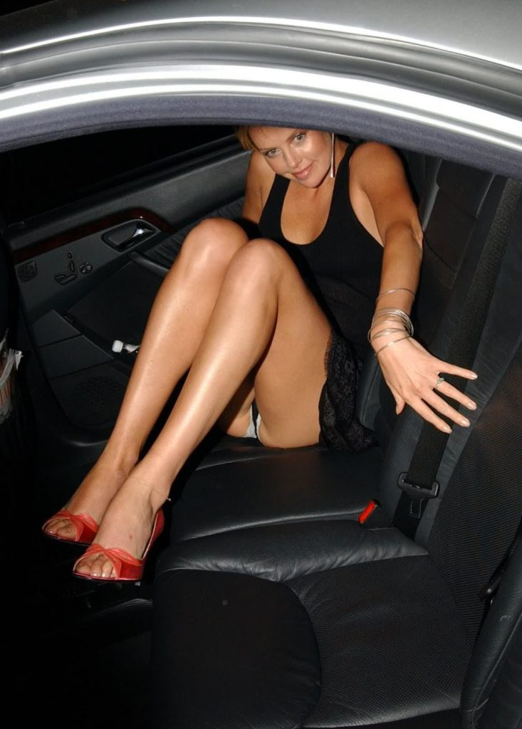 Charlize Theron black dress car upskirt