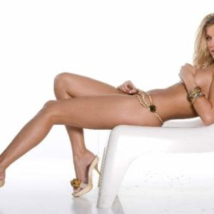 The dazzling Joanna Krupa leaning back on white chair