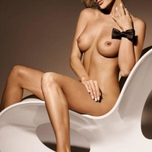 The leggy Joanna Krupa completely nude with bow on her wrist
