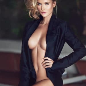 the delightful Joanna Krupa showing off her cleavage wearing a blazer