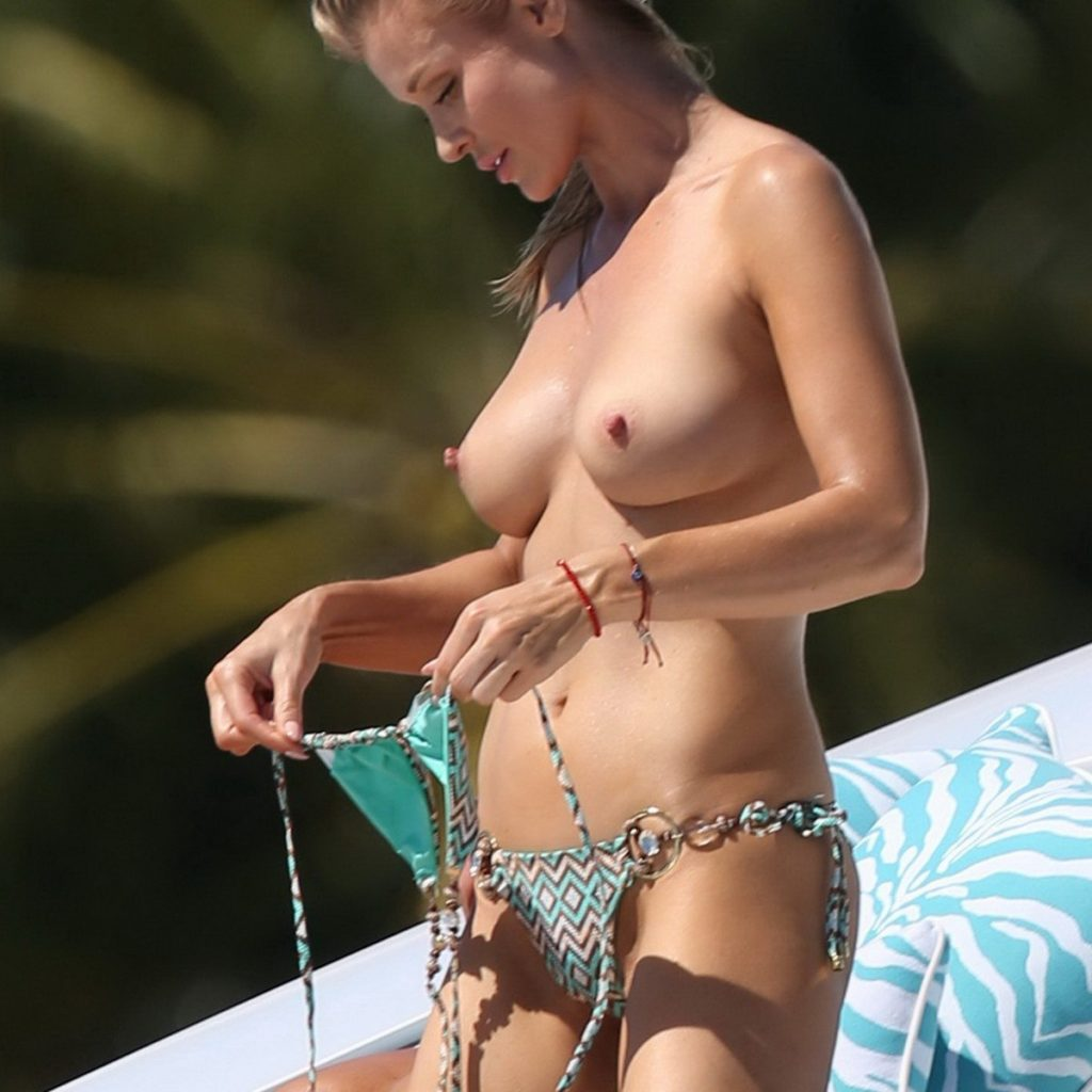The reality television star Joanna Krupa topless in the sunshine