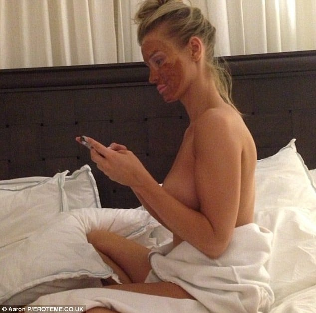 The babe Joanna Krupa topless in bed with mask on her face