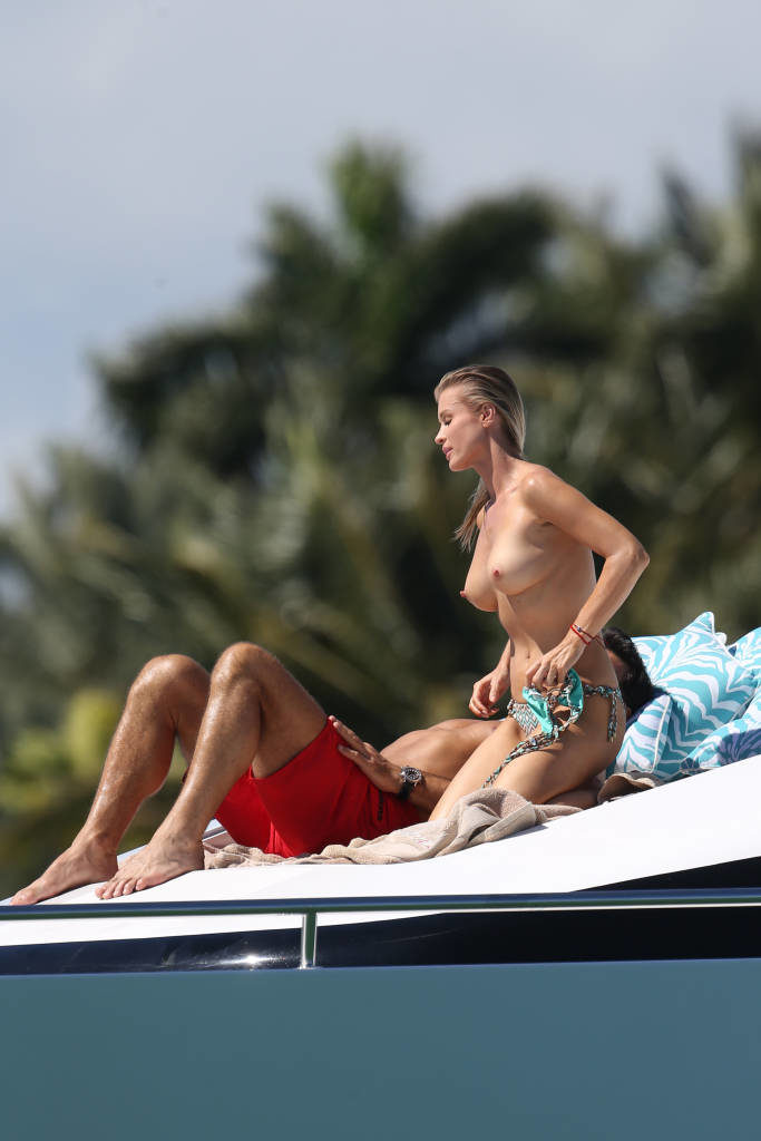 The stunning Joanna Krupa topless on a boat with her boyfriend