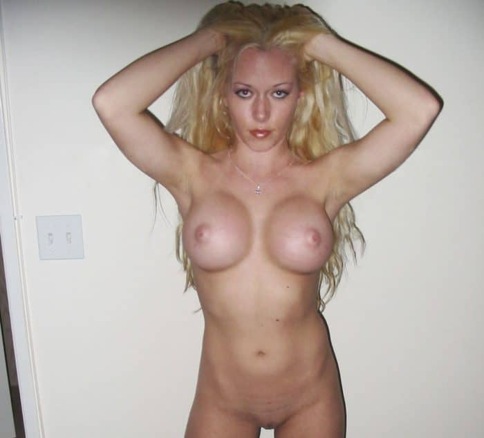 Kendra Wilkinson holding her hair up