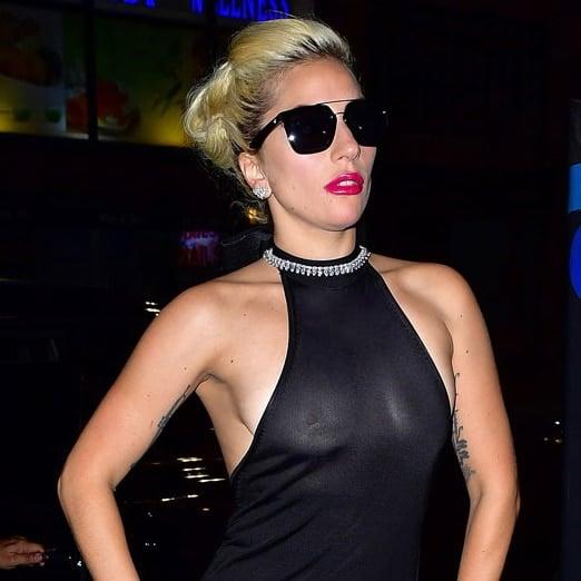 Singer Lady Gaga wearing black sunglasses and black halter top showing her nipples