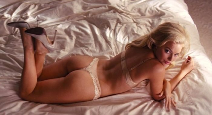 Margot Robbie in Wolf of Wall street baring her ass cheeks in bed