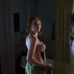 The supple Scarlett Johansson in the bathroom covering her breast