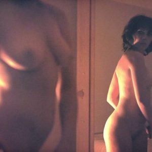 The sex kitten Scarlett Johansson looking at her self in a mirror in the nude