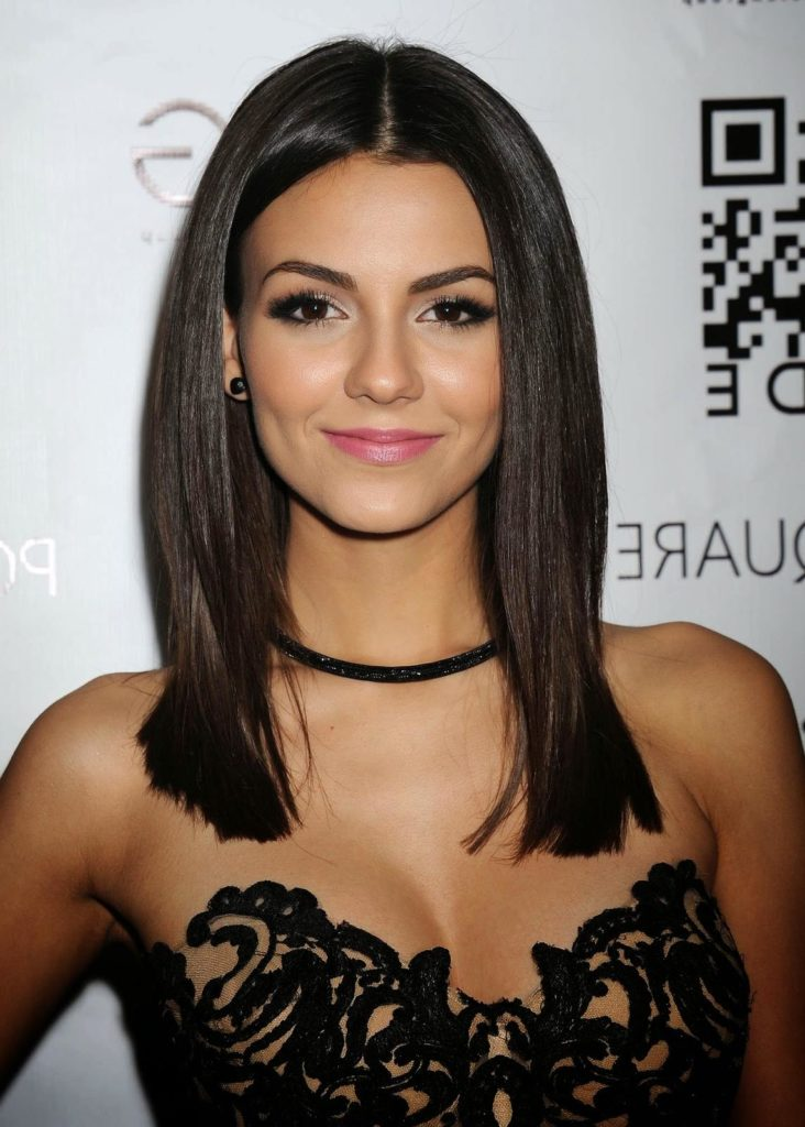 The singer Victoria Justice in black lacy dress wearing a choker