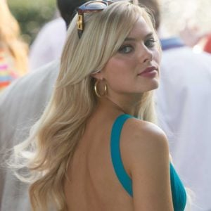 Margot Robbie looking stunning in a turquoise dress