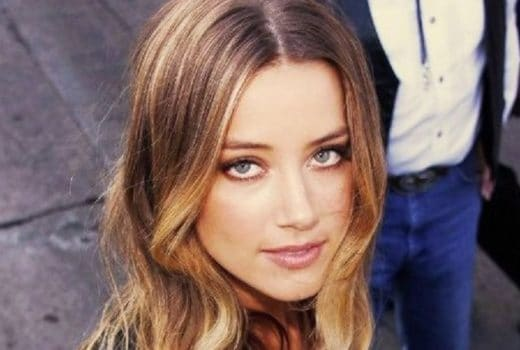 beautiful actress amber heard looking up at the camera