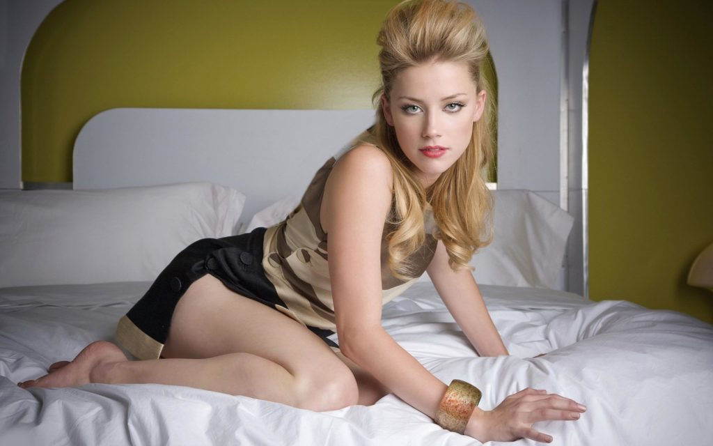 celeb Amber Heard on all fours in bed