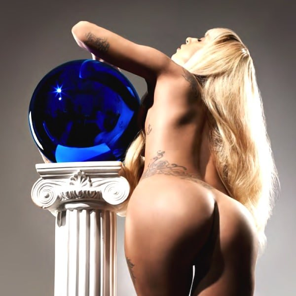 The talented Lady Gaga completely nude leaning against a pillar