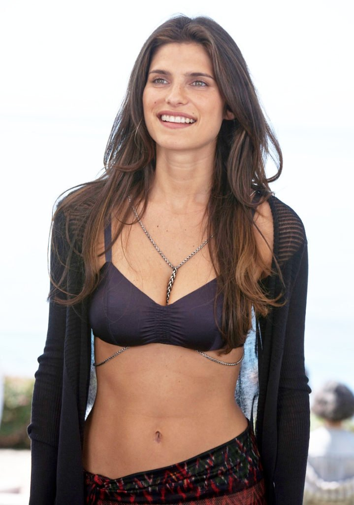 Lake Bell smiling big in bikini, shawl, and sarong