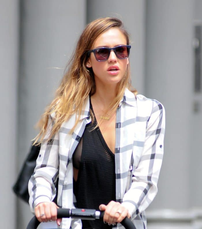 Actress Jessica Alba suffers a nipple slip in black tank top pushing a stroller