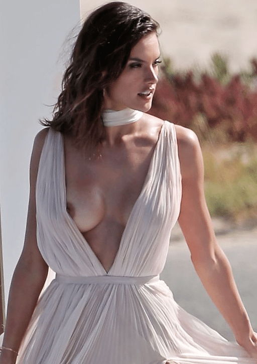 Alessandra Ambrosio in sheer cream gown with nipple coming out of the top