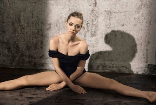 Beautiful actress amanda seyfried doing the splits for Glamour magazine
