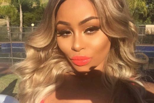 Celebrity Blac Chyna with blonde hair and red lips takes a selfie