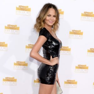 Chrissy Teigen in hot black shiny mini dress