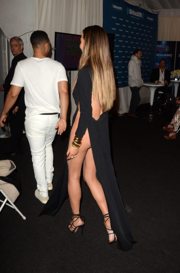Chrissy Teigen walking away in gown at the 2016 American Music awards showing her ass
