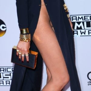 Close up photo of Chrissy Teigen in black gown showing her legs and pussy at the American Music Awards in 2016