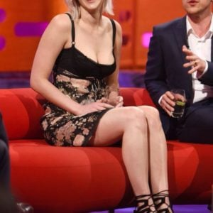Jennifer Lawrence sitting on red couch after upskirt moment