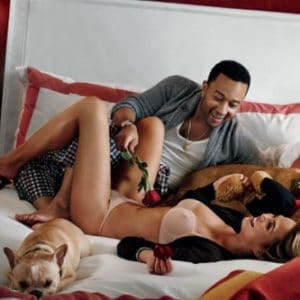 John Legend in bed with wife Chrissy Teigen and their french bull dog