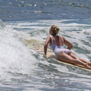 Margot Robbie butt showing while surfing