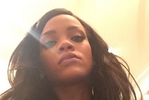 Rihanna taking a selfie with long hair