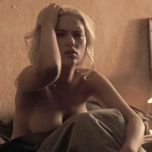 Scarlett Johansson in movie scene sitting on bed