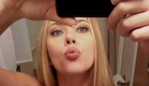 Scarlett Johansson taking a mirror selfie and making a kissy face
