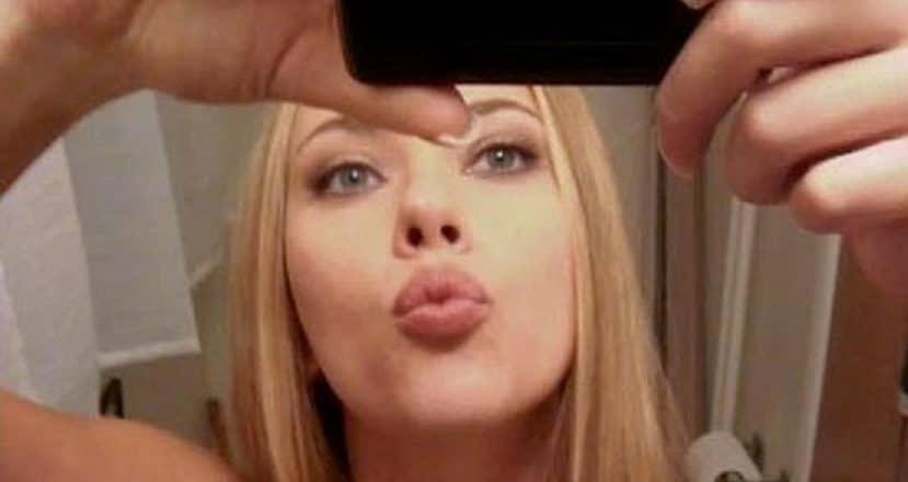 Scarlett Johansson taking a mirror selfie and making a kissy face