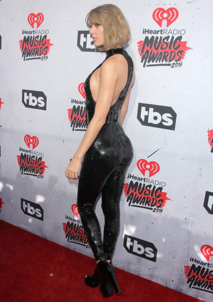 Taylor Swift in skin tight black jumpsuit