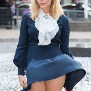 The wind blowing up Elizabeth Olsen's navy blue dress