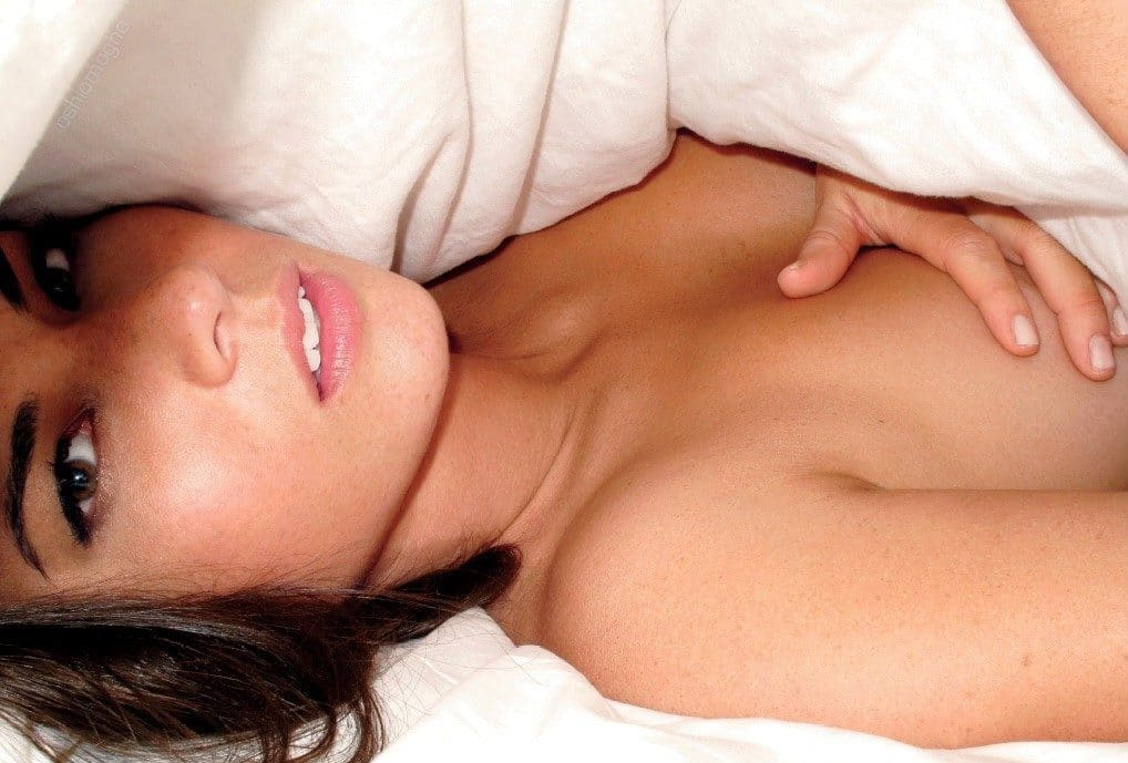 Topless Olivia Munn underneath the covers
