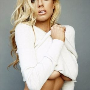 model charlotte mckinney showing her under tits in white sweater while modeling