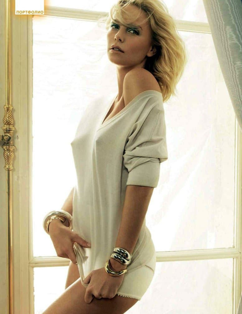 celebrity stunner charlize theron models in white tshirt with nipples poking through and looking damn hot