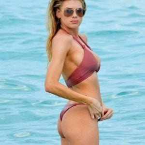 charlotte mckinney showing off her ass cheeks in a red bikini