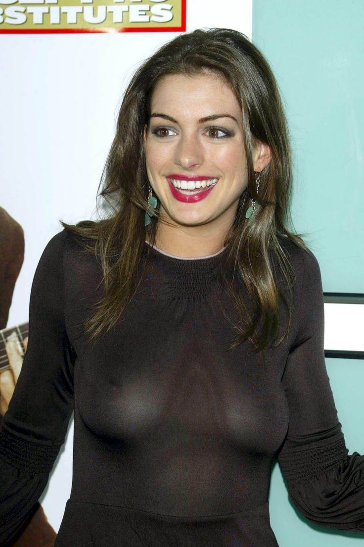 See through black top on Anne Hathaway showing her voluptuous breasts
