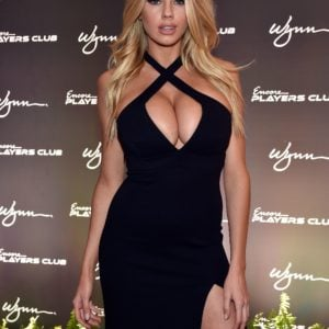 charlotte mckinney in black dress showing lots of cleavage at awards show