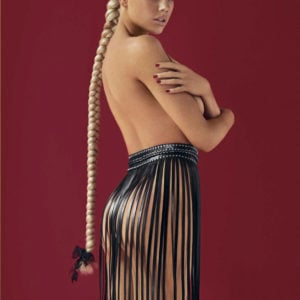 model charlotte mckinney poses topless with long braid for gq mexico