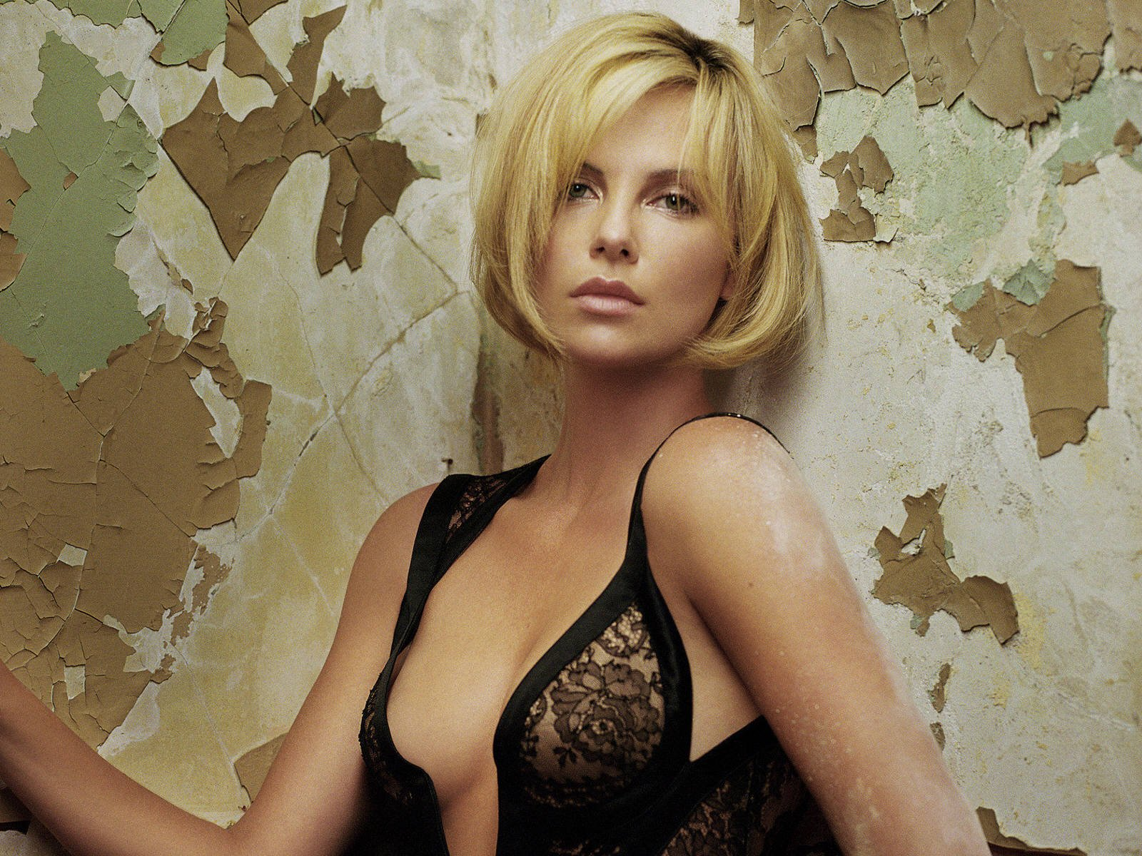 modeling photo of charlize theron in a sexy black see through lingerie top with a blonde bob