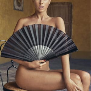 totally naked charlotte mckinney with only black fan covering her naked body