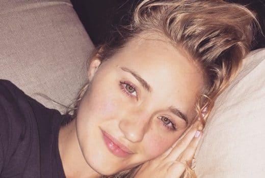 AJ Michalka selfie laying on a pillow