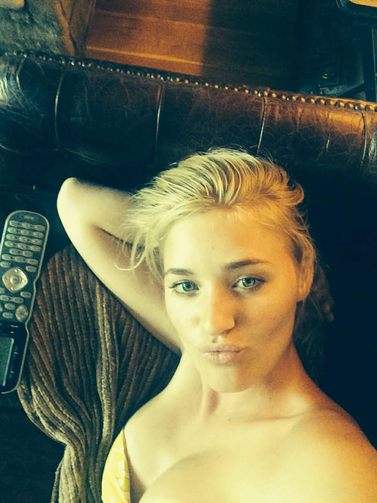 AJ Michalka taking a selfie resting her head on her arm